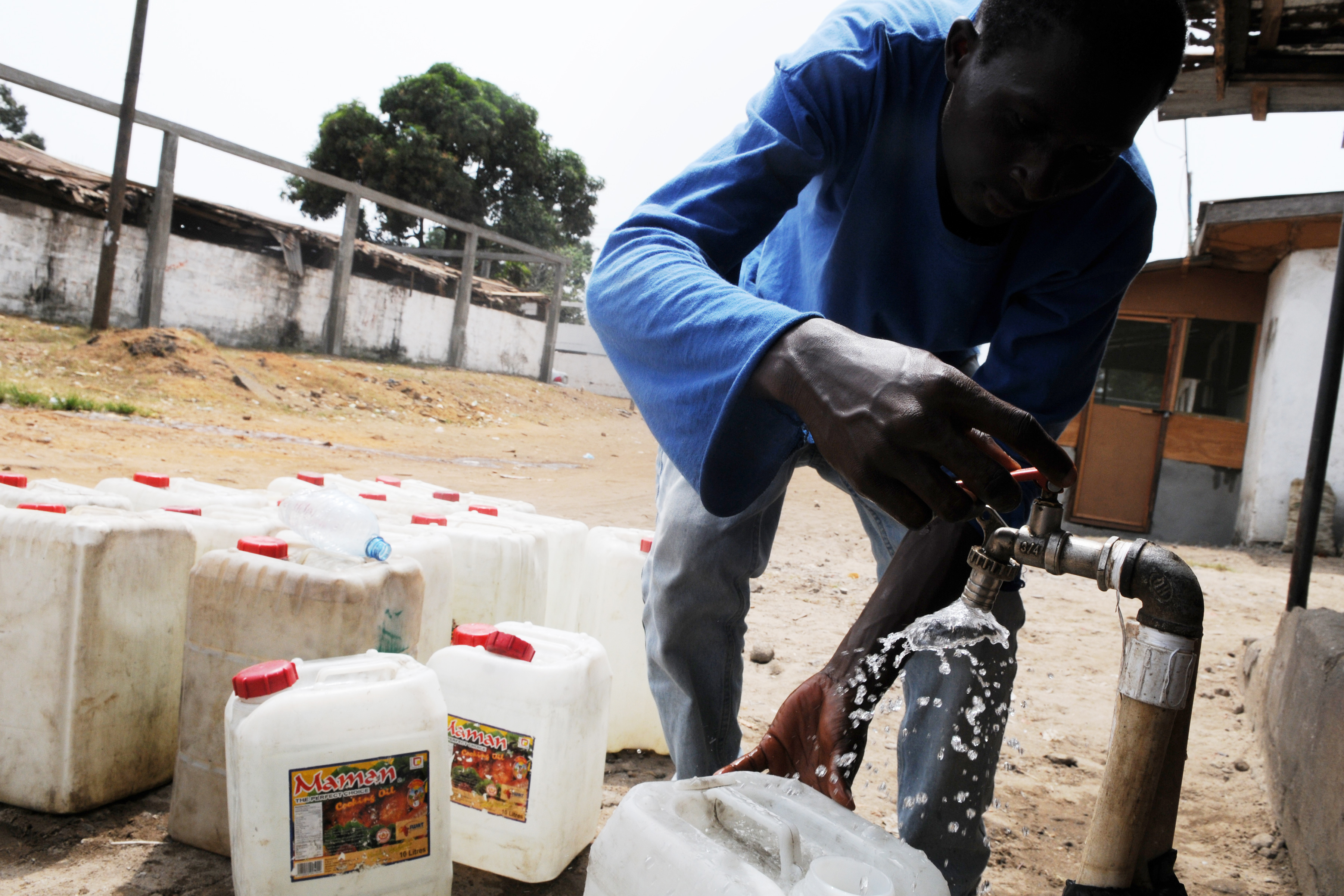 Collecting water tap in Liberia. UN Photo/Emmanuel Tobey