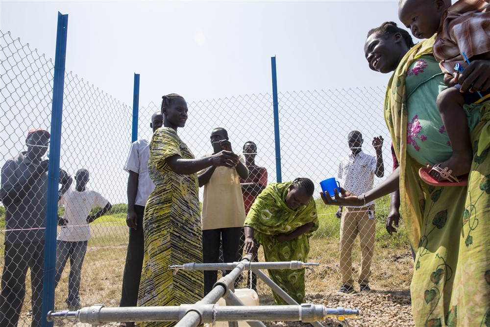 Handover of solar-powered water pump to local community to the community of Gormoyok village in Rejaf Payam in South Sudan.