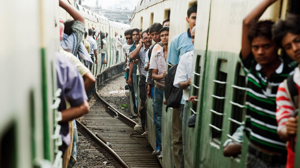 A view of passengers aboard trains connecting the suburbs of Kolkata, India. The Asia-Pacific region is urbanizing rapidly with 1.77 billion people, 43% of the region's population, living in urban areas. UN Photo/Kibae Park
