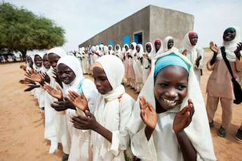 Girls in Kuma Garadayat, North Darfur, celebrate the inauguration of their new school as part of the six development projects in the areas of education, sanitation, health, community development and women empowerment. Photo by Albert González Farran - UNAMID