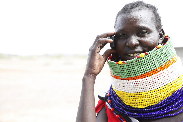 Turkana woman uses her mobile photo to communicate in Kalobeyei town, one of Kenya's integrated settlements that uses planned urbanization. Photo: Julius Mwelu/UN-Habitat